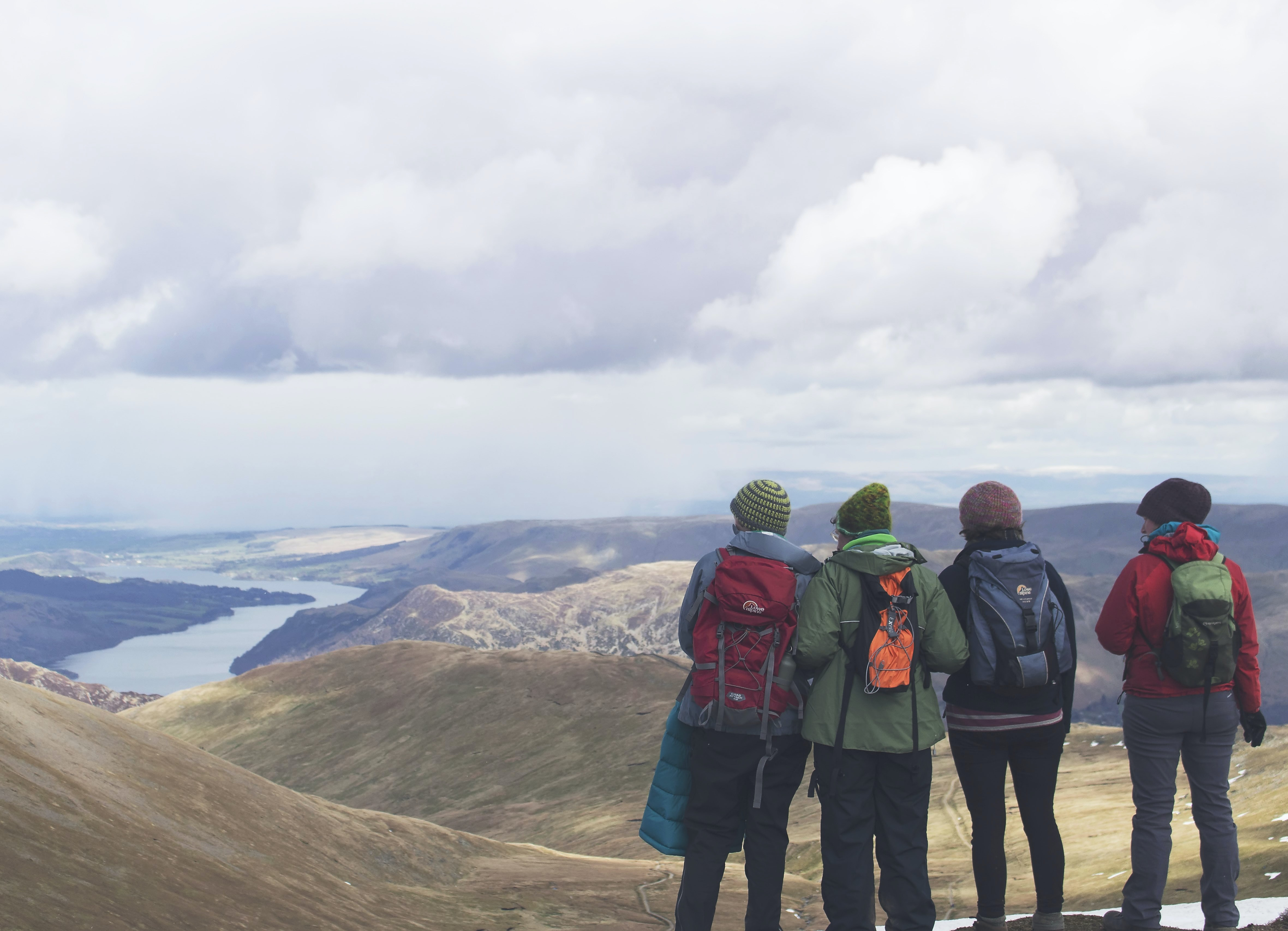 Group of hikers looking at the view from a high point on Helvellyn mountain