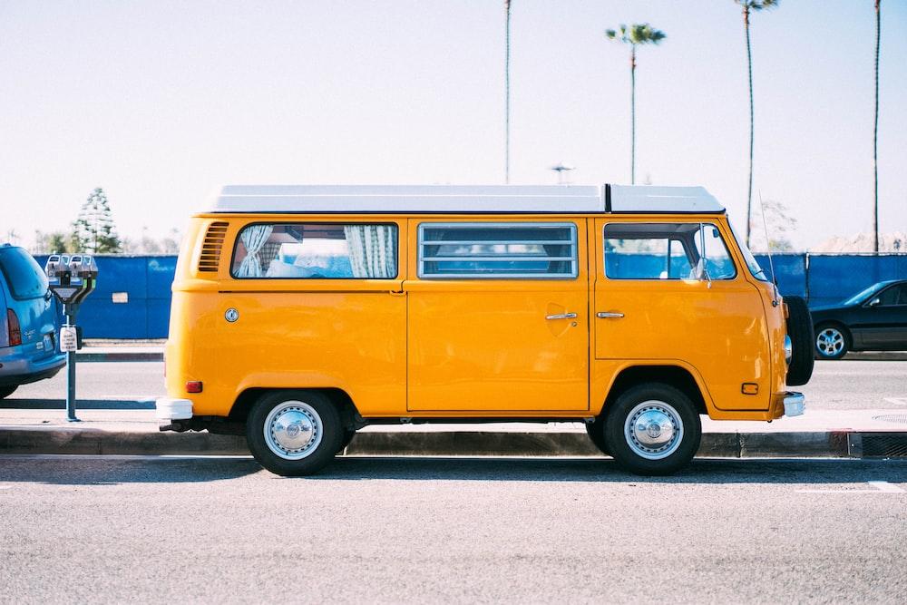yellow minivan on parking lot