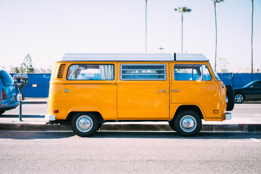 Old fashioned yellow passenger bus