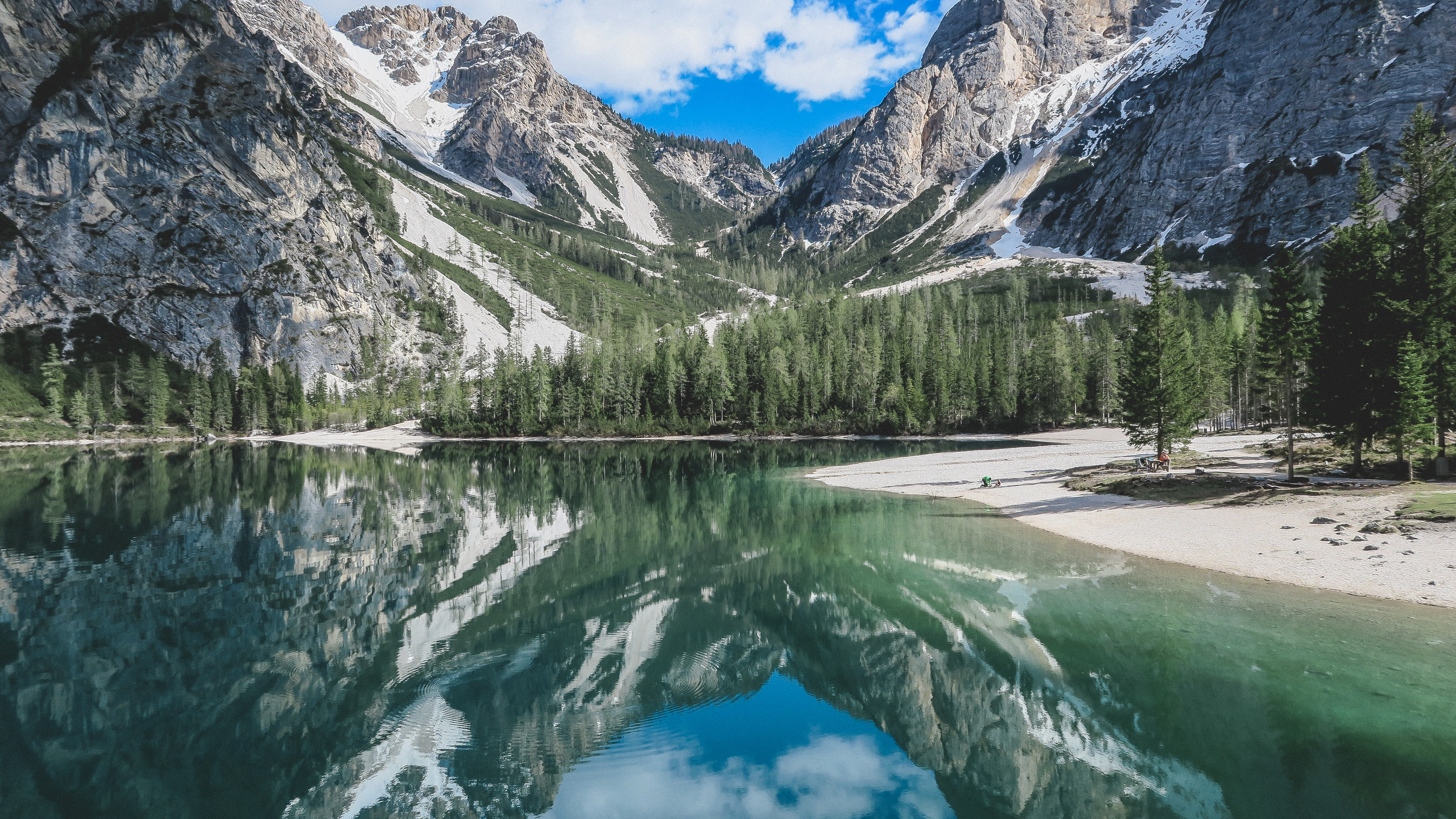 Mountain reflected in the emerald-green surface of the Pragser Wildsee lake