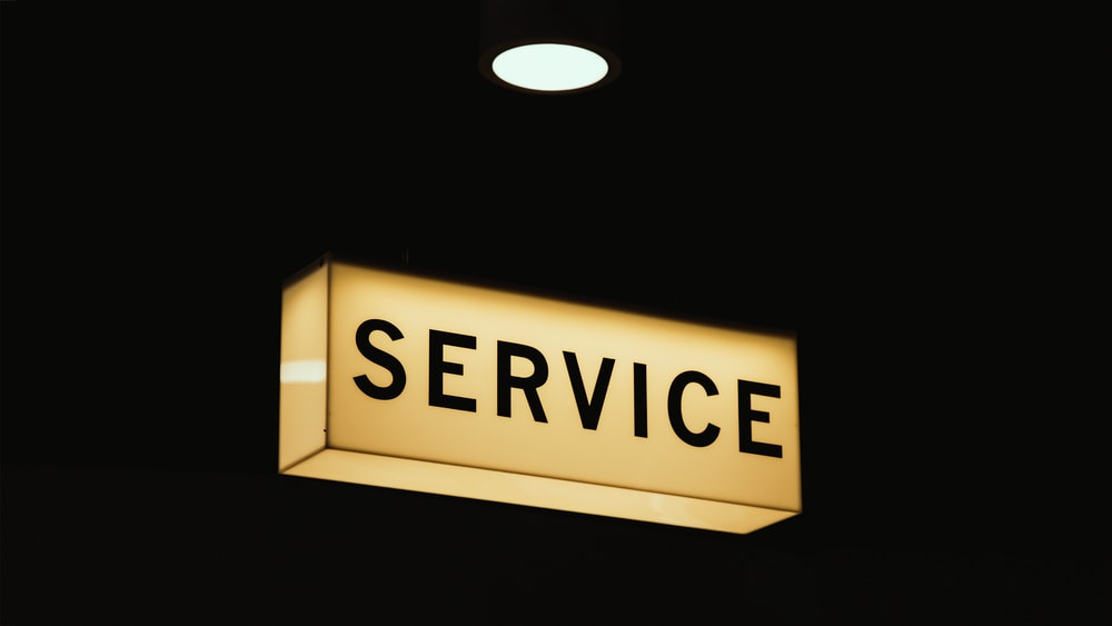 "A ""service"" sign in a room lit up at night"