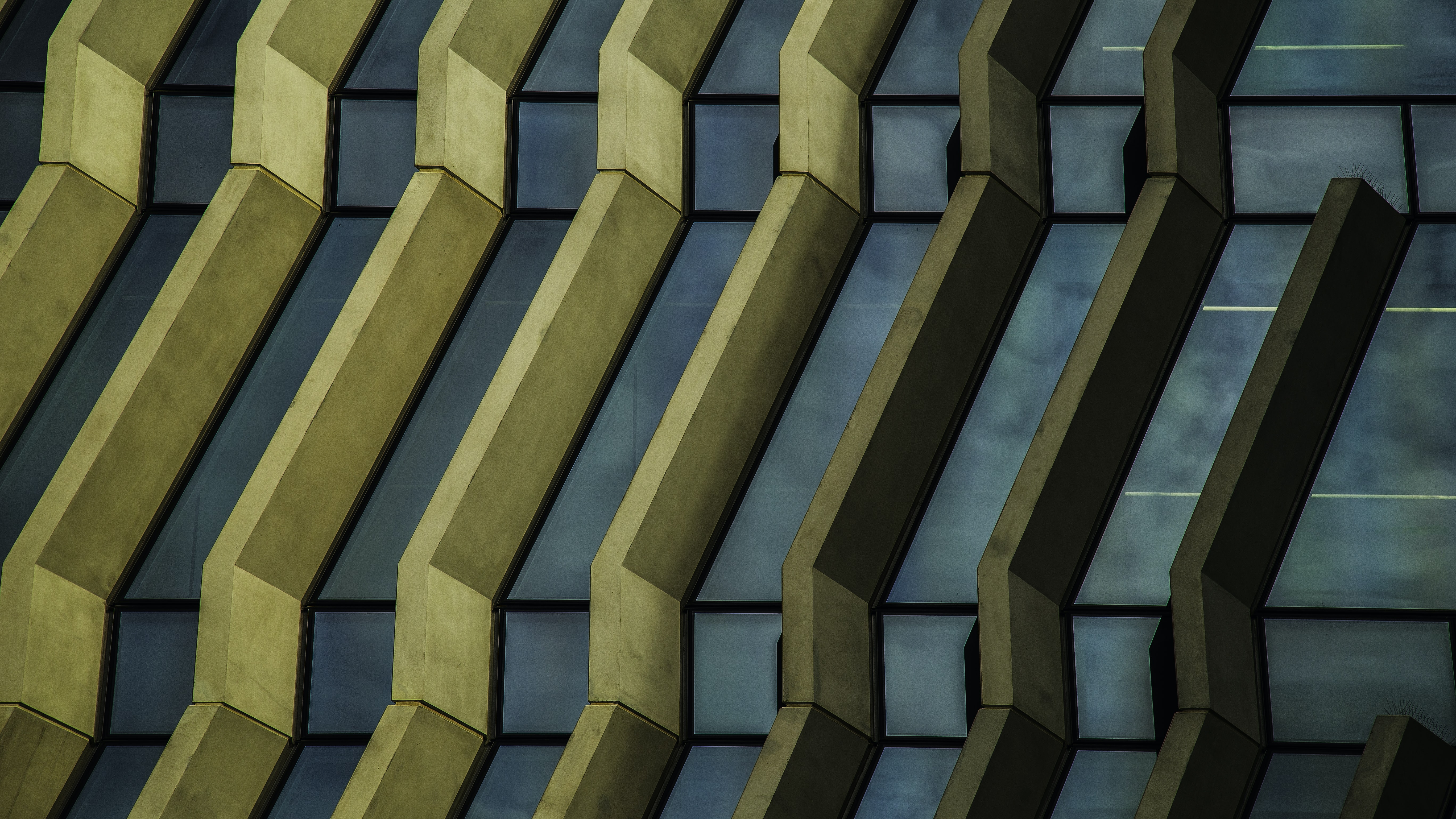 Yellow ribs in a blue building facade
