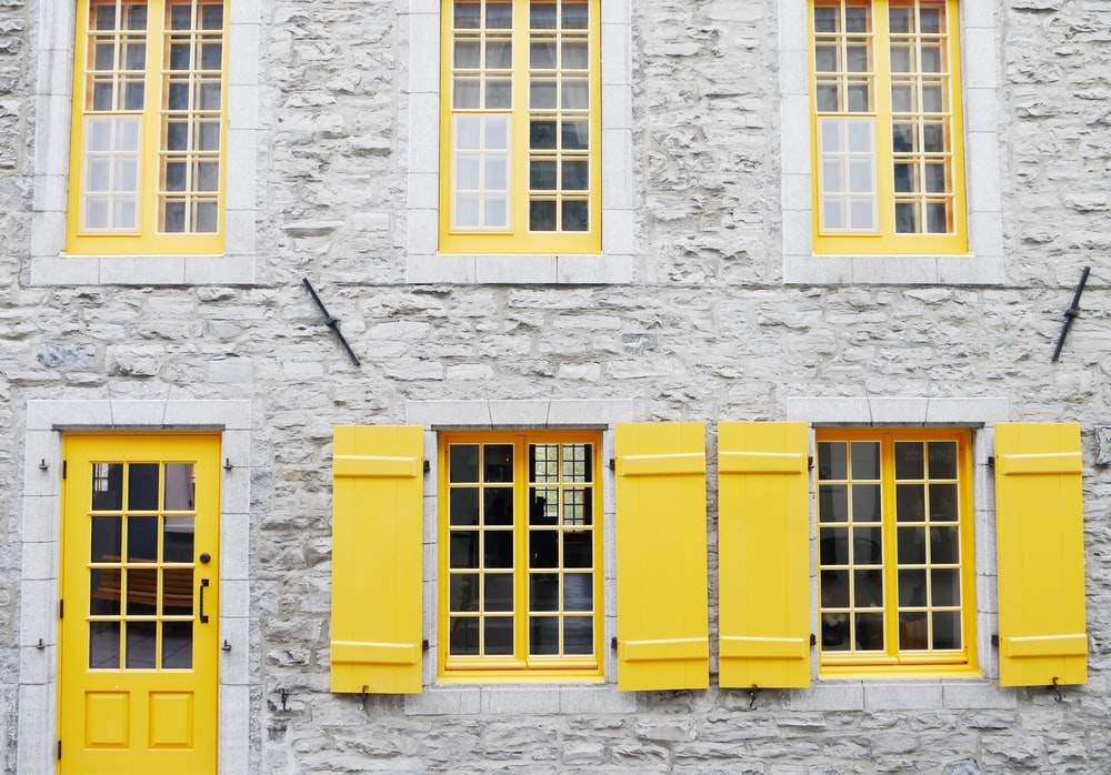 gray and yellow concrete house