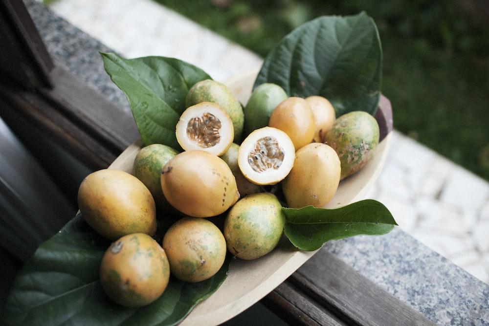 orange fruits on brown tray