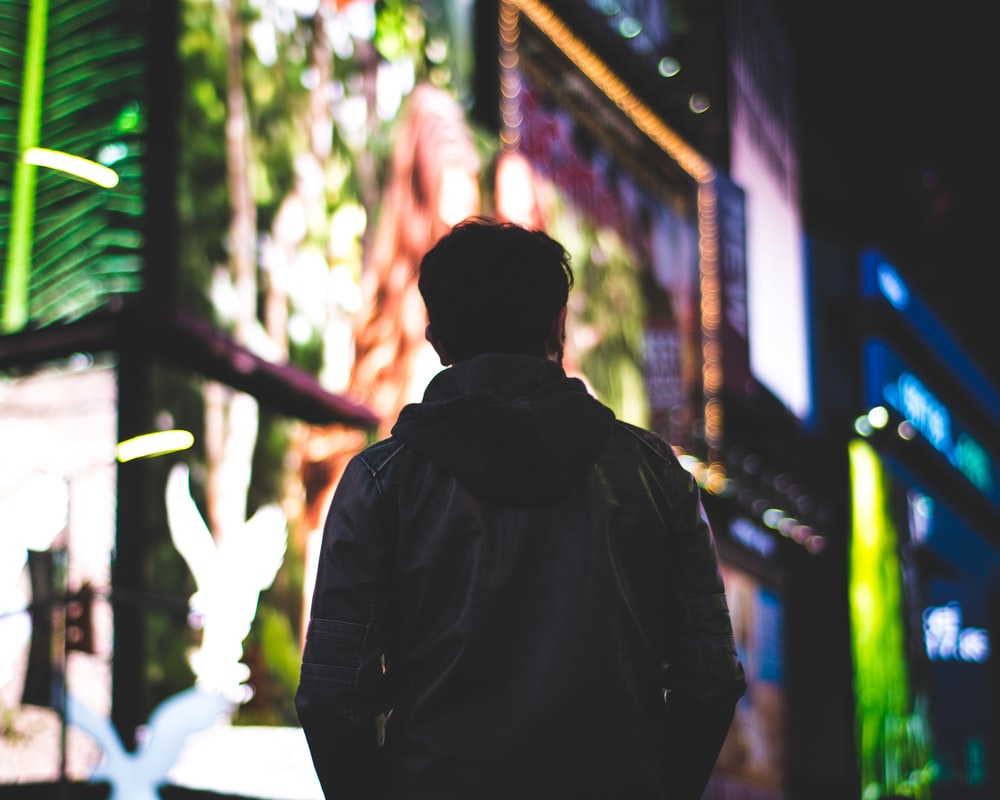 closeup photo of man wearing black hoodie jacket
