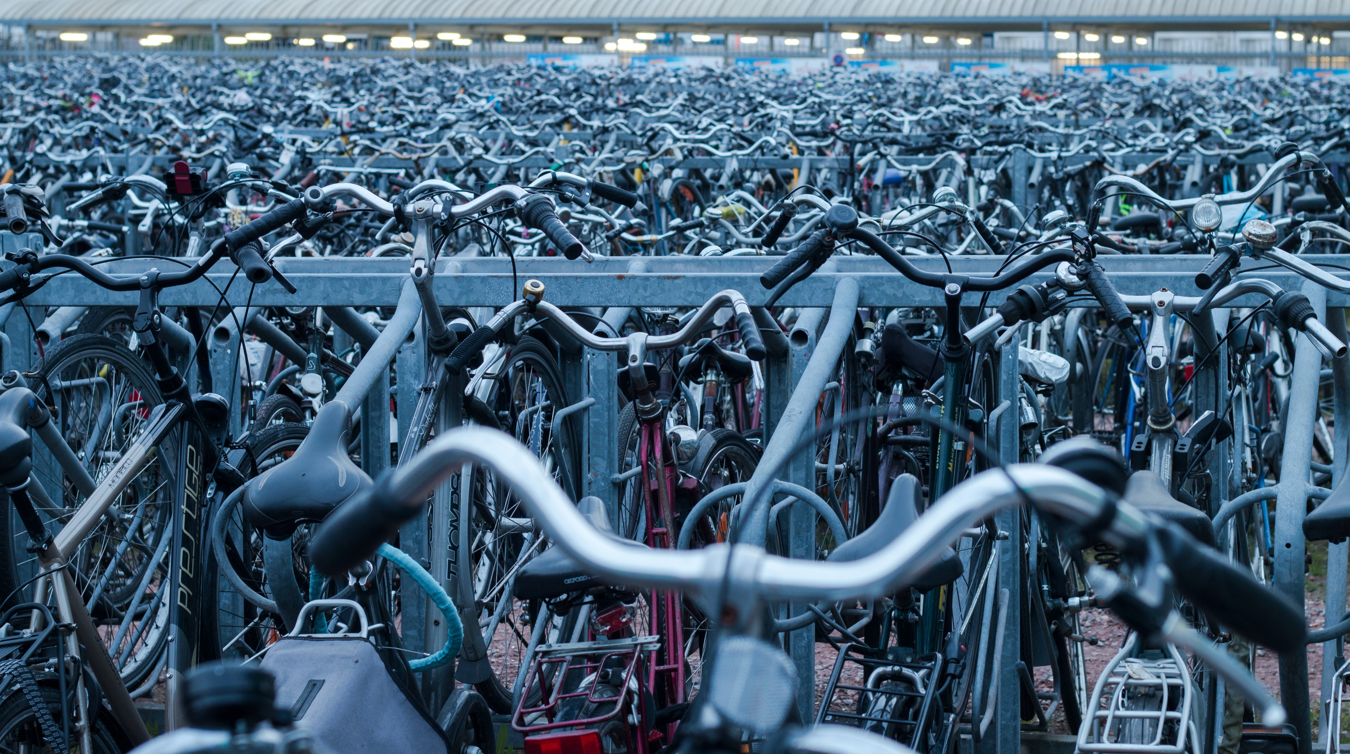 Endless lines of full bike racks with bicycles