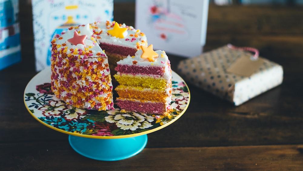 sliced cake on cake riser