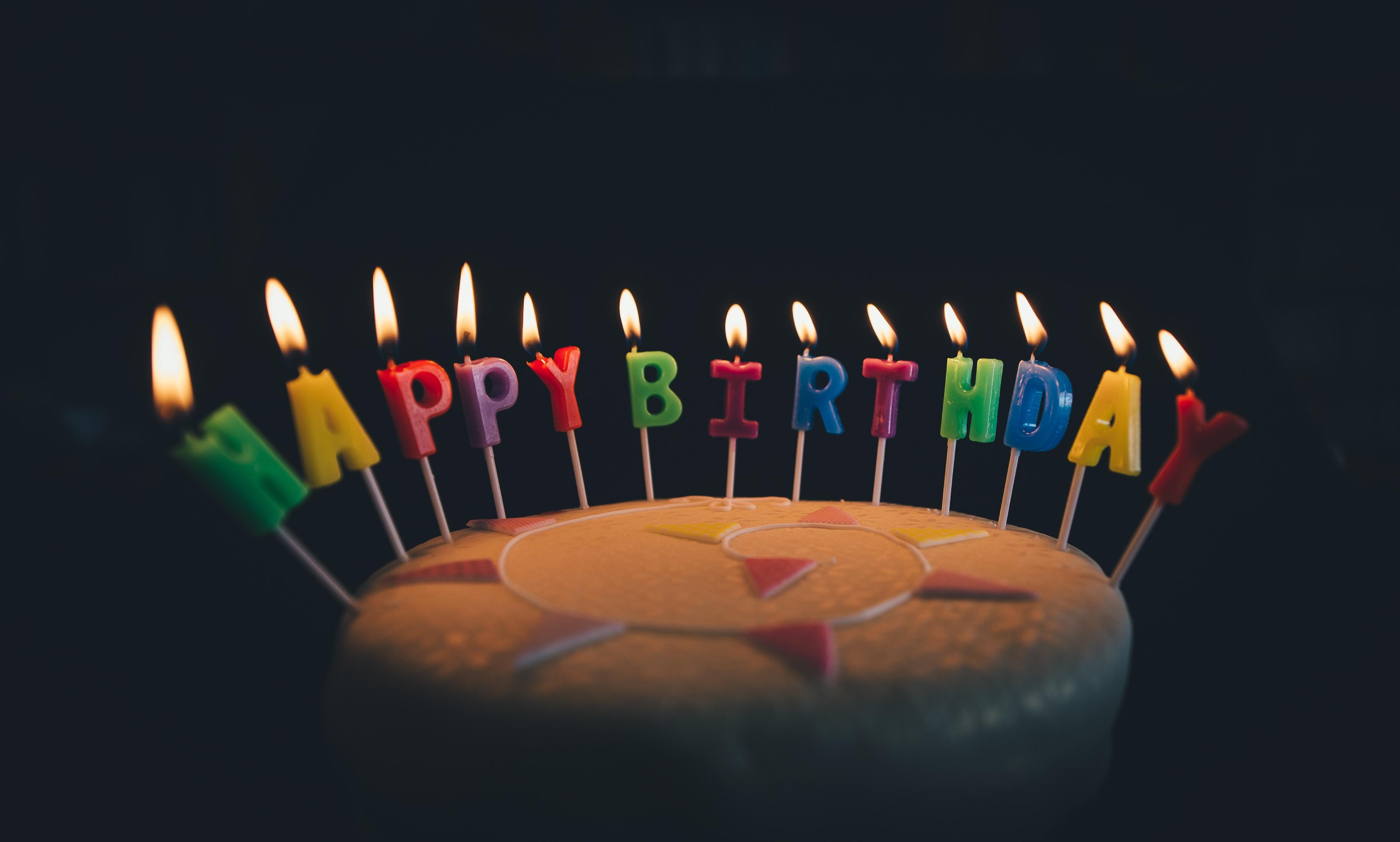 round fondant cake with happy birthday candle