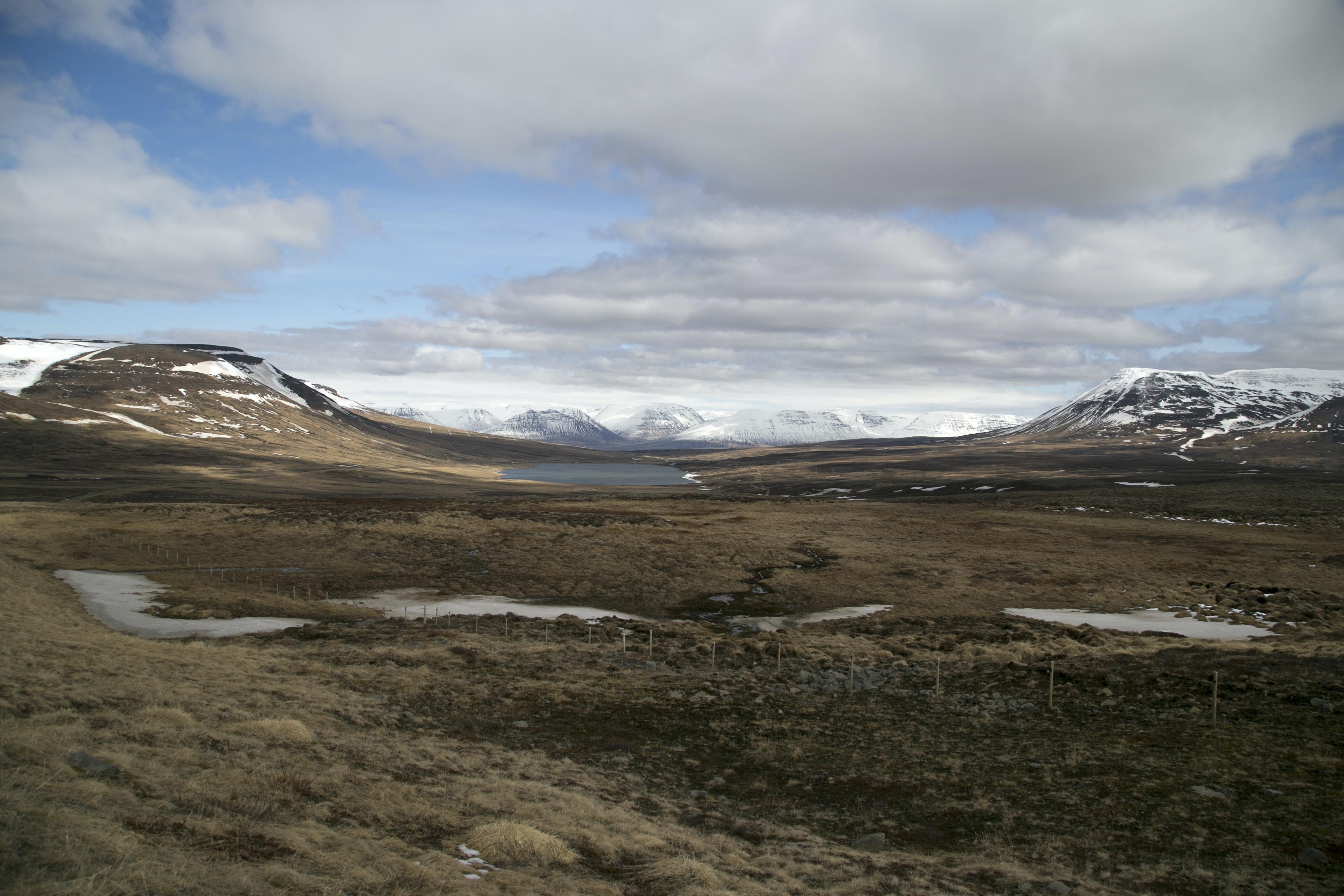 land within mountain range during daytime