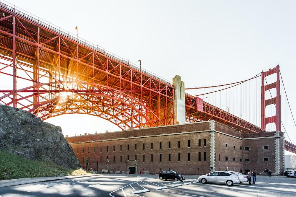 brown concrete building under bridge