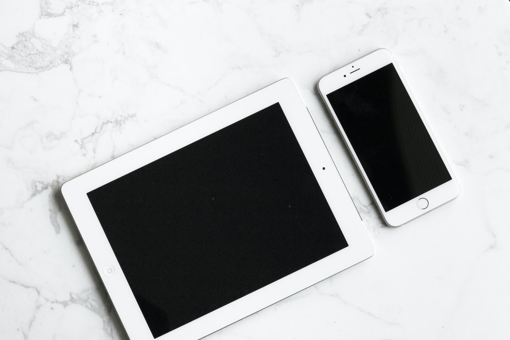 white iPad and silver iPhone 6