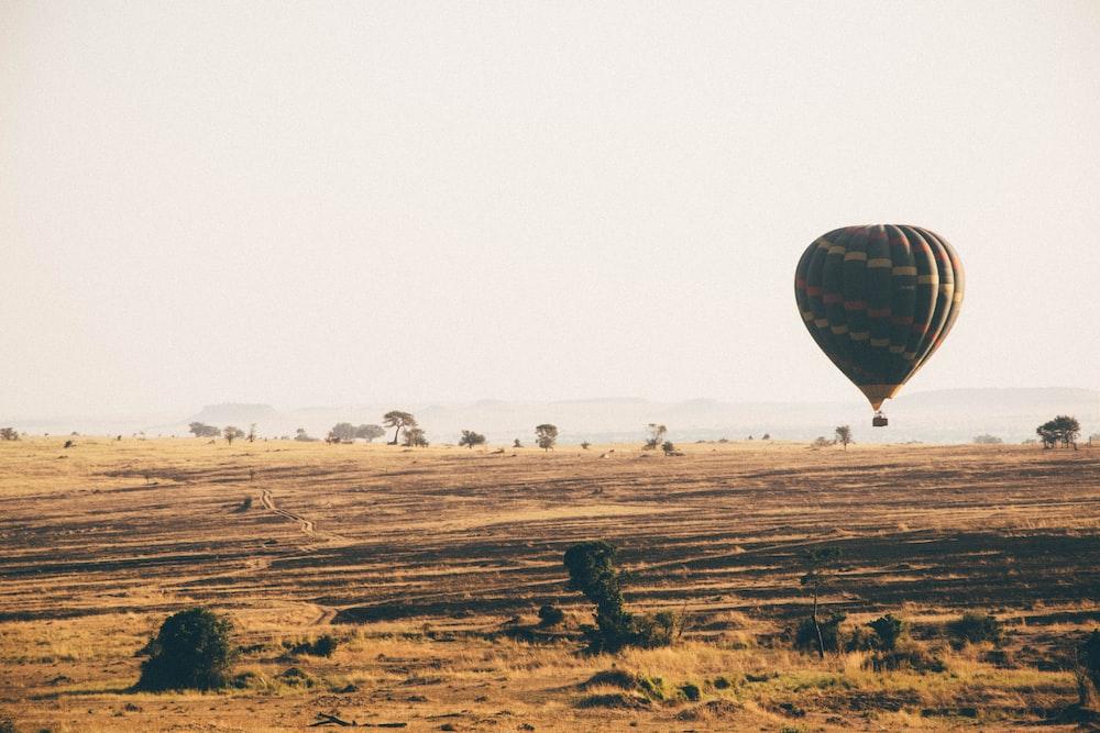 brown hot air balloon during dayime