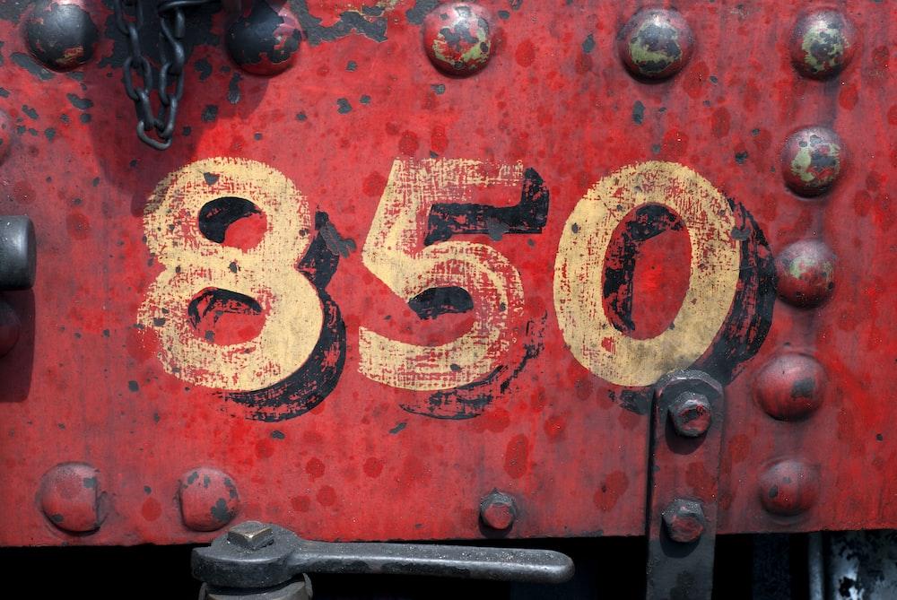 850-printed on red metal panel