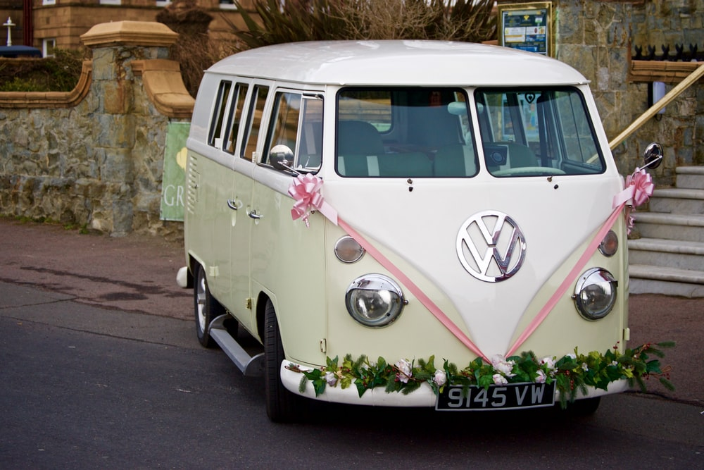 white Volkswagen bus parked on road