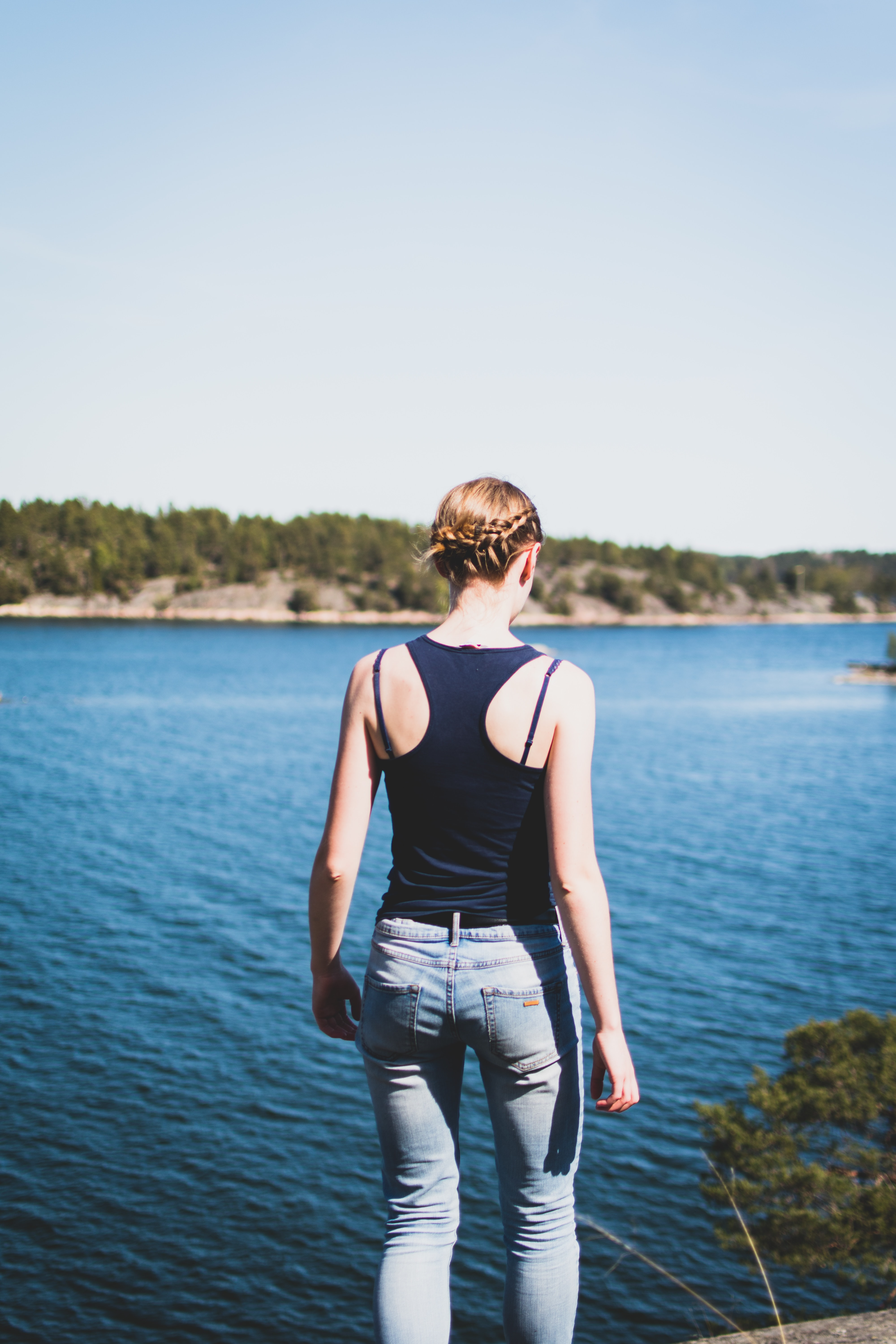 woman fronting body of water