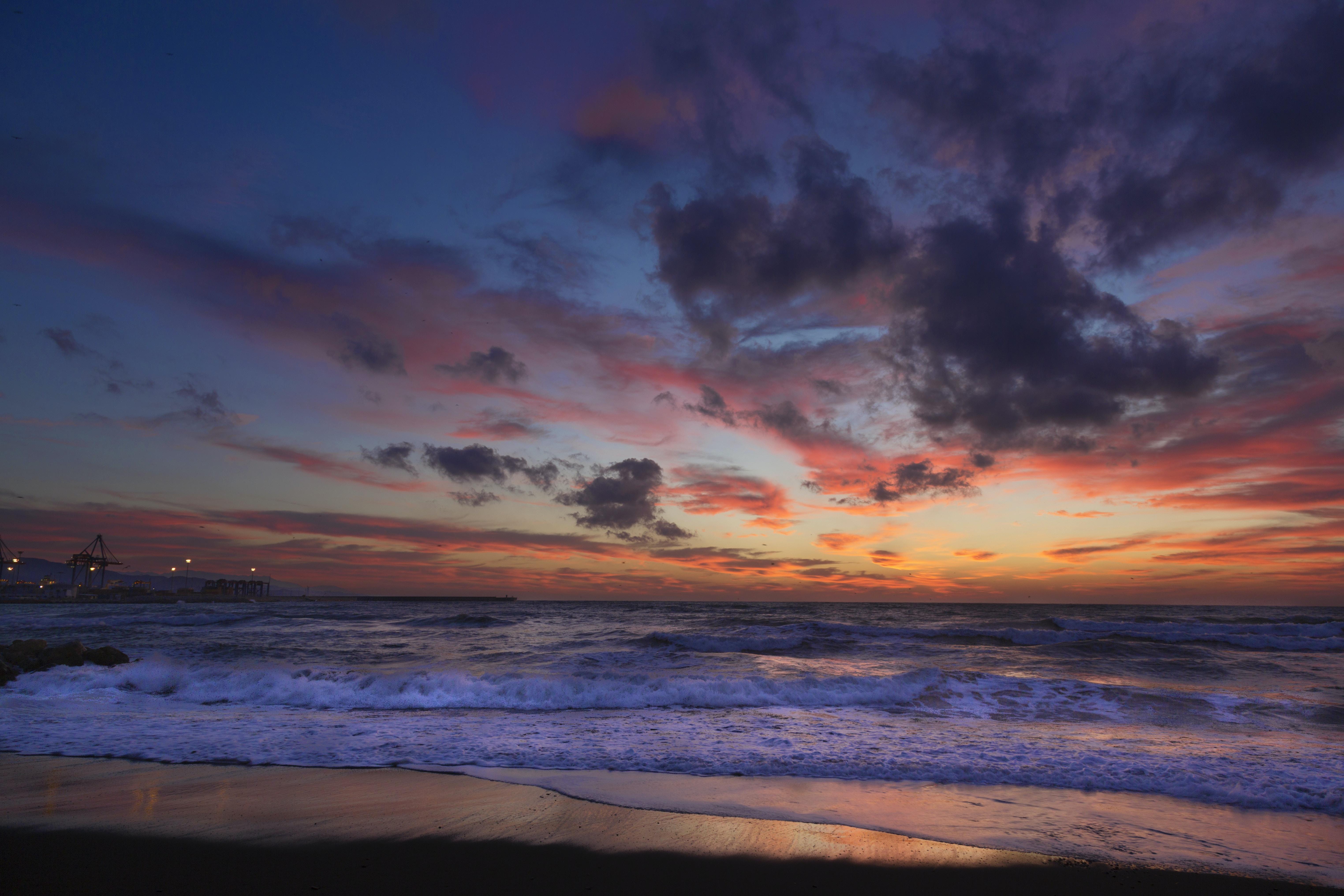 ocean waves near seashore during golden hour