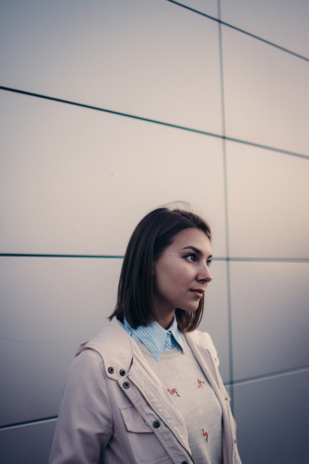 woman in white jacket looking forward