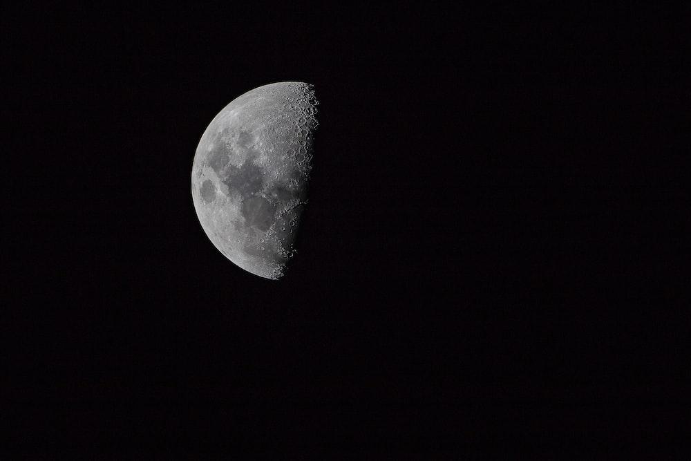 half moon on pitch dark sky
