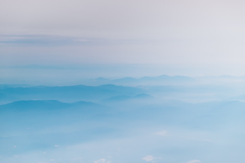 mountain covering with clouds