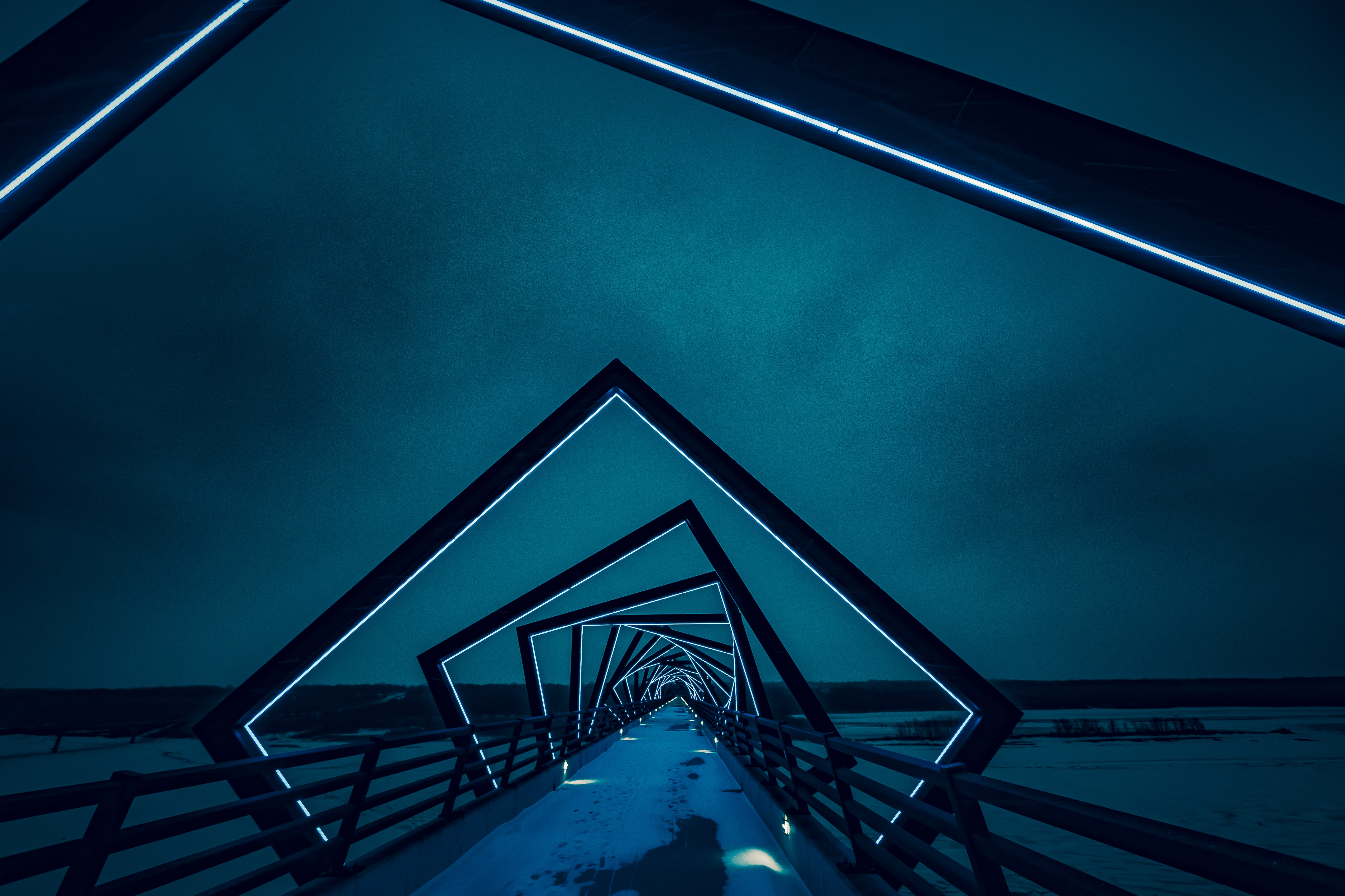 Modern geometric neon bridge architecture at night on walkway, High Trestle Trail Bridge