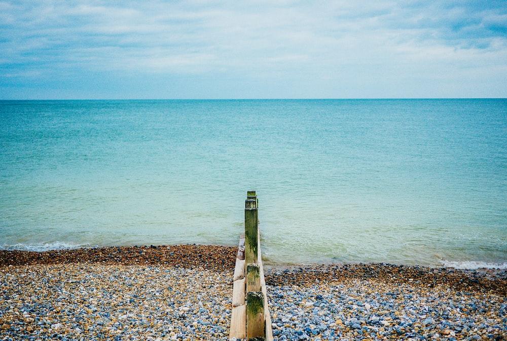 rocks near calm ocean