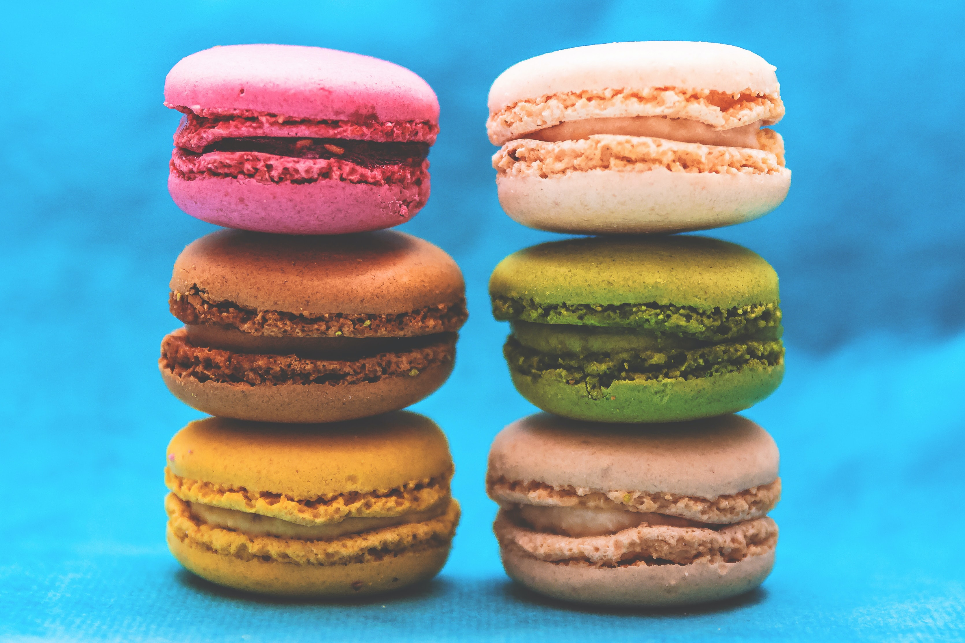 Macaroons in pink, green, brown, and yellow