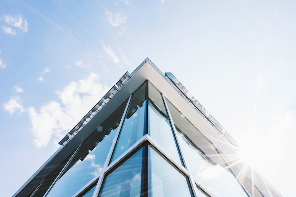 glass building wall under clear sky