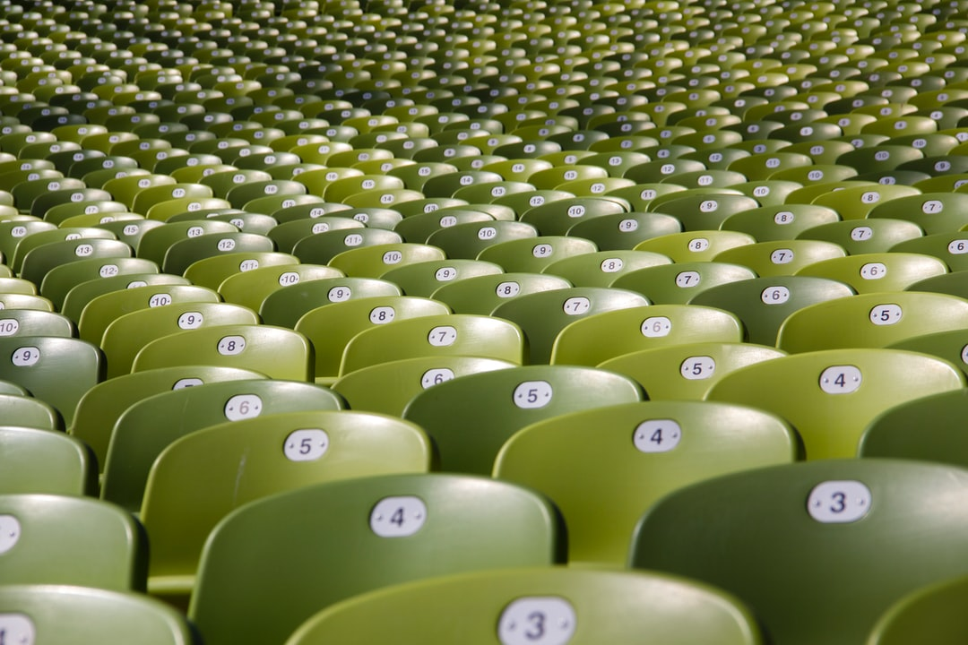 Rows of numbered stadium seats.