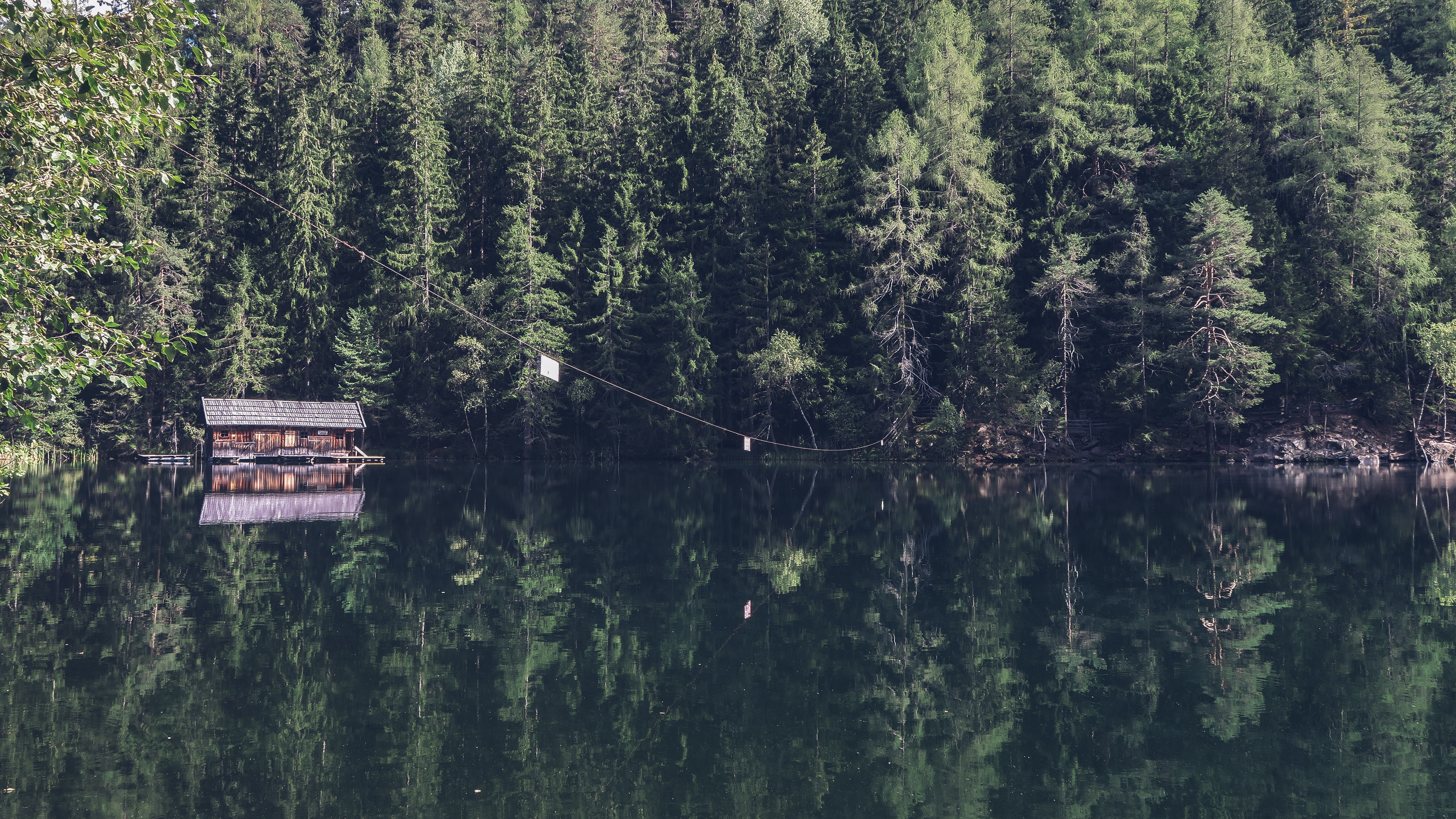 A cabin on a quiet lake on a sunny day