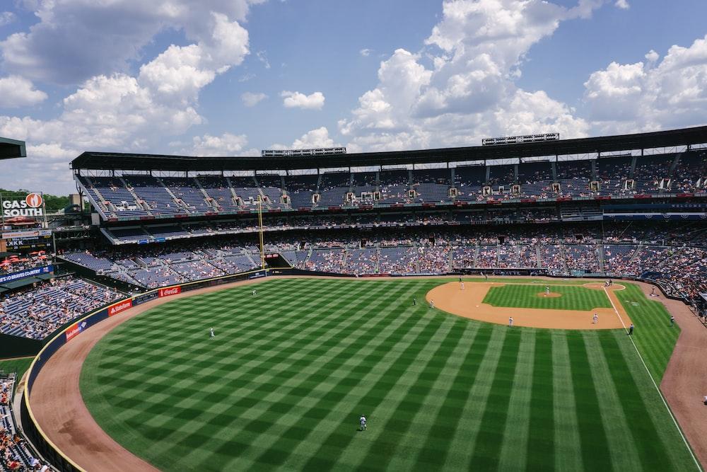 skyline photography of green ballpark