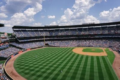 skyline photography of green ballpark baseball teams background