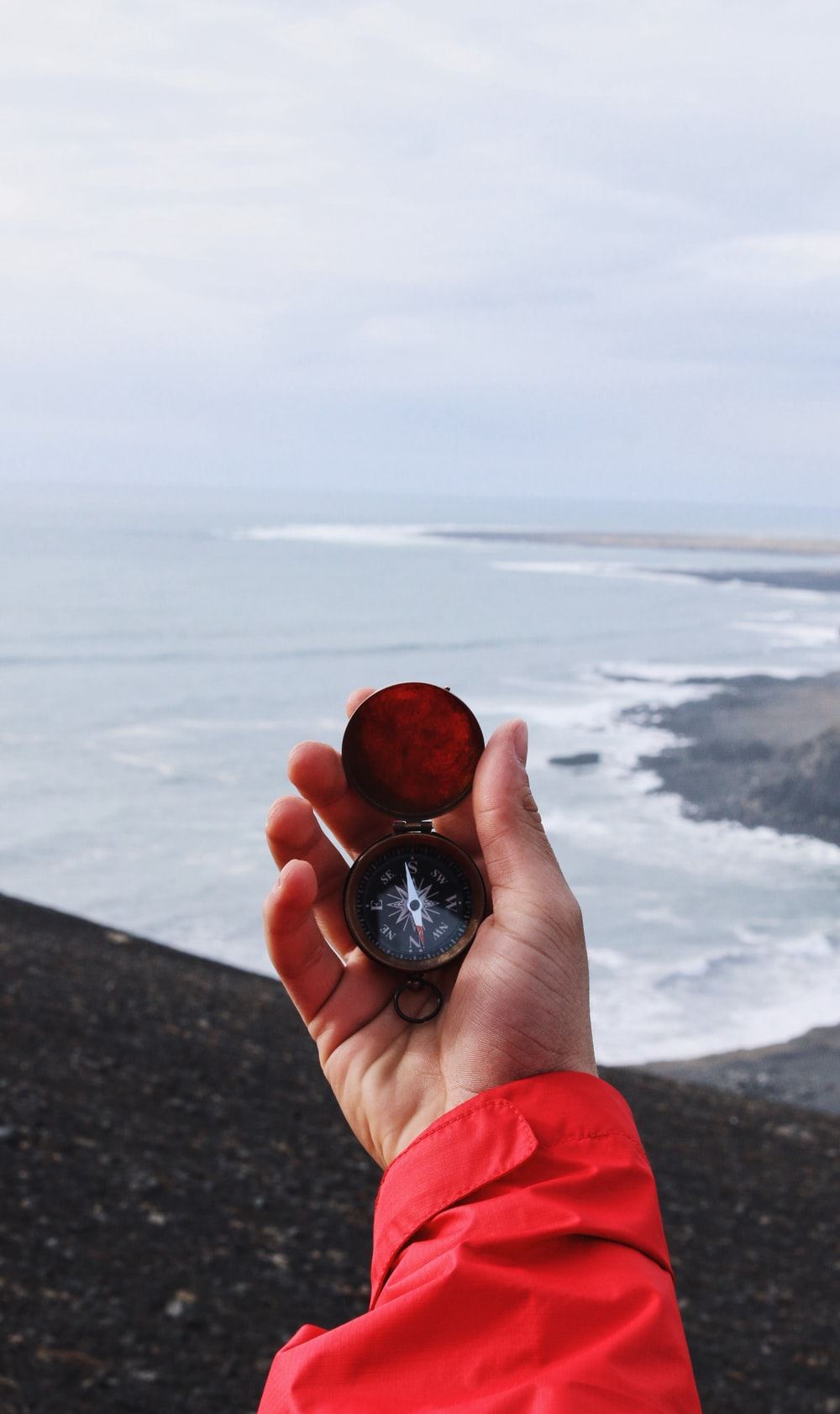 person holding compass