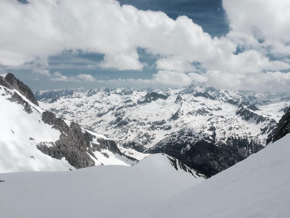 mountain alps under cumulus clouds