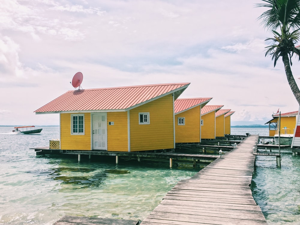 photo of brown houses on body of water