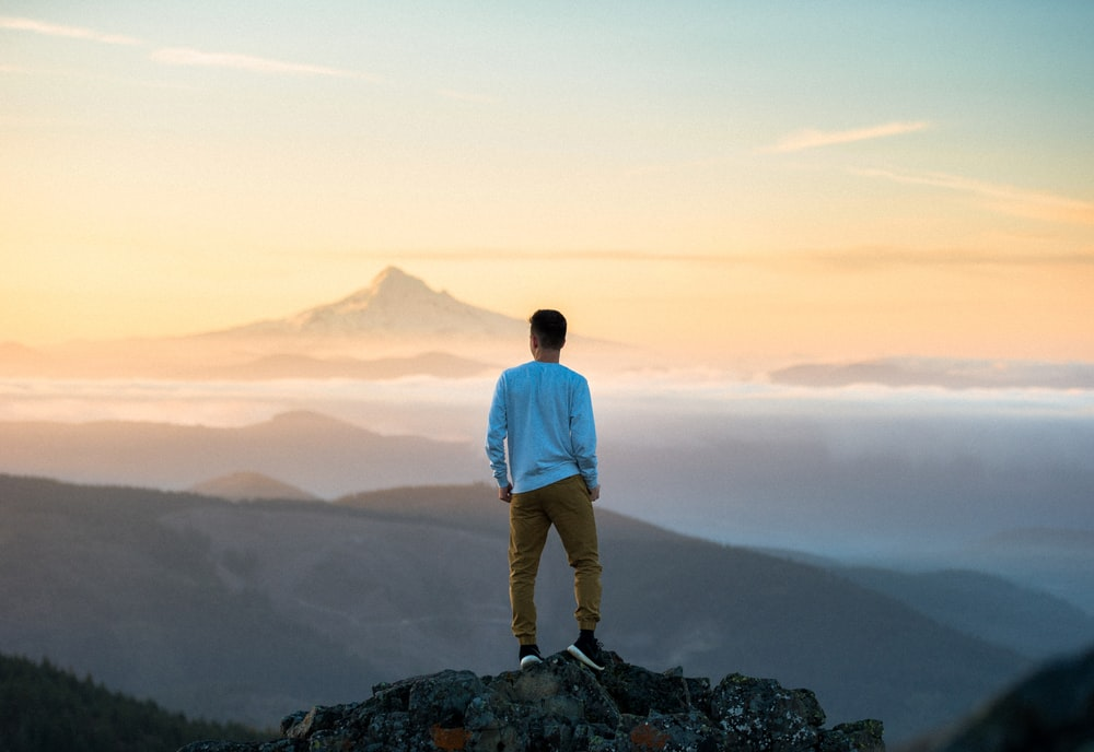 Person standing on a rocky peak of the mountains of Silver Rock