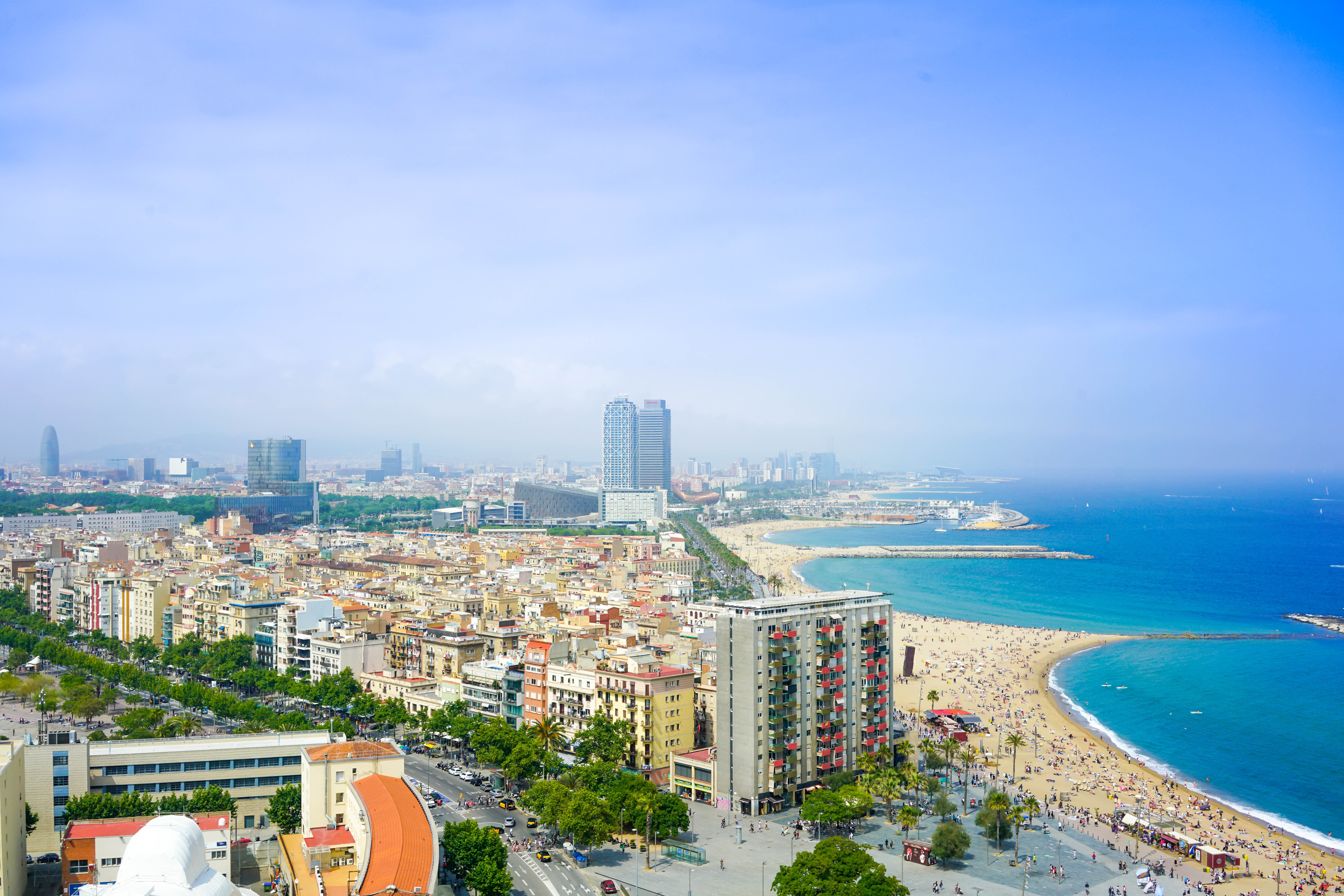 Beautiful cityscape summer view of high-rise around beach in Barcelona just around the blue ocean