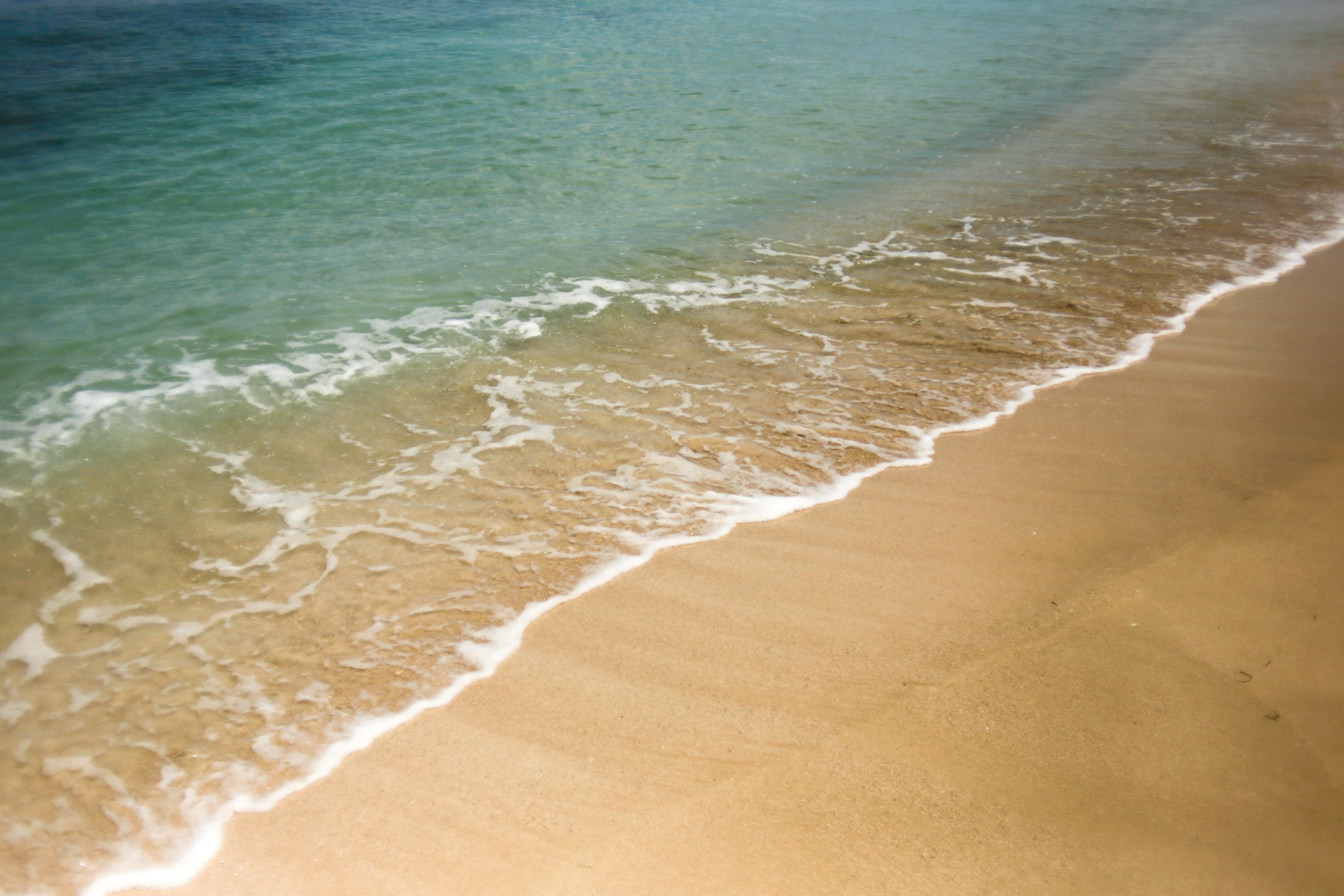 Clear ocean washing on the fine sand beach