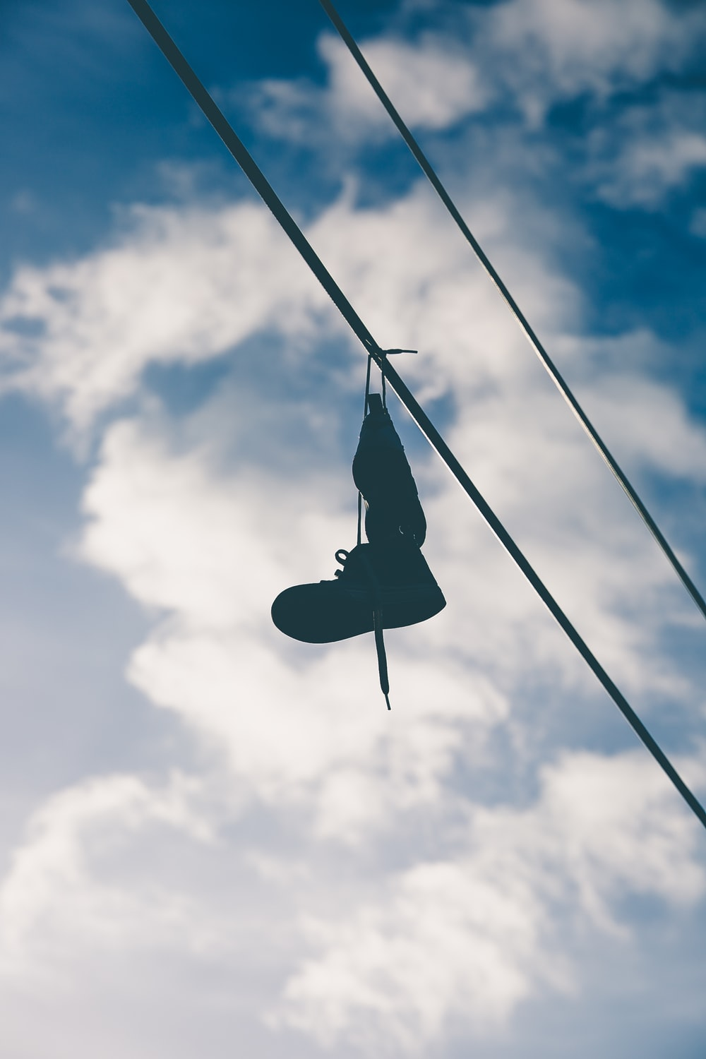 black boot hung on wire