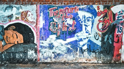 brick wall covered in colorful graffiti art cairo teams background