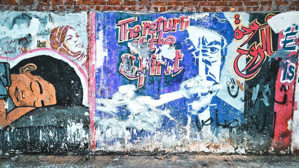Brick wall covered in colorful graffiti art