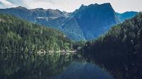 body of water within mountain range during daytime