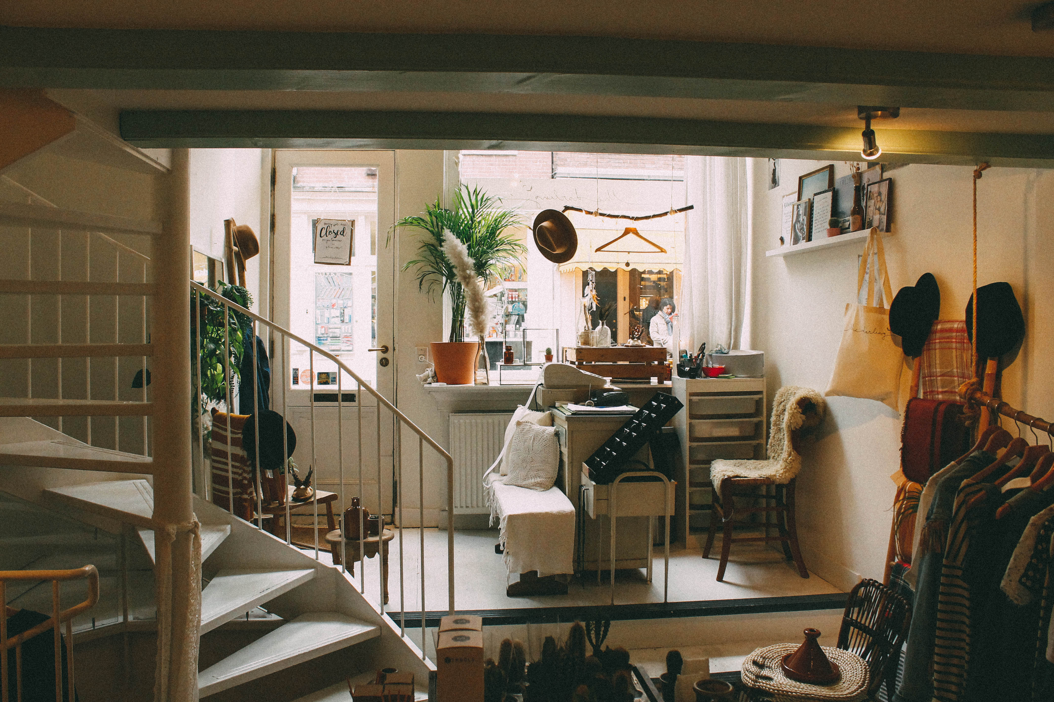 A Busy Living Room With Various Trinkets And Decorations And A Window Looking Out On The