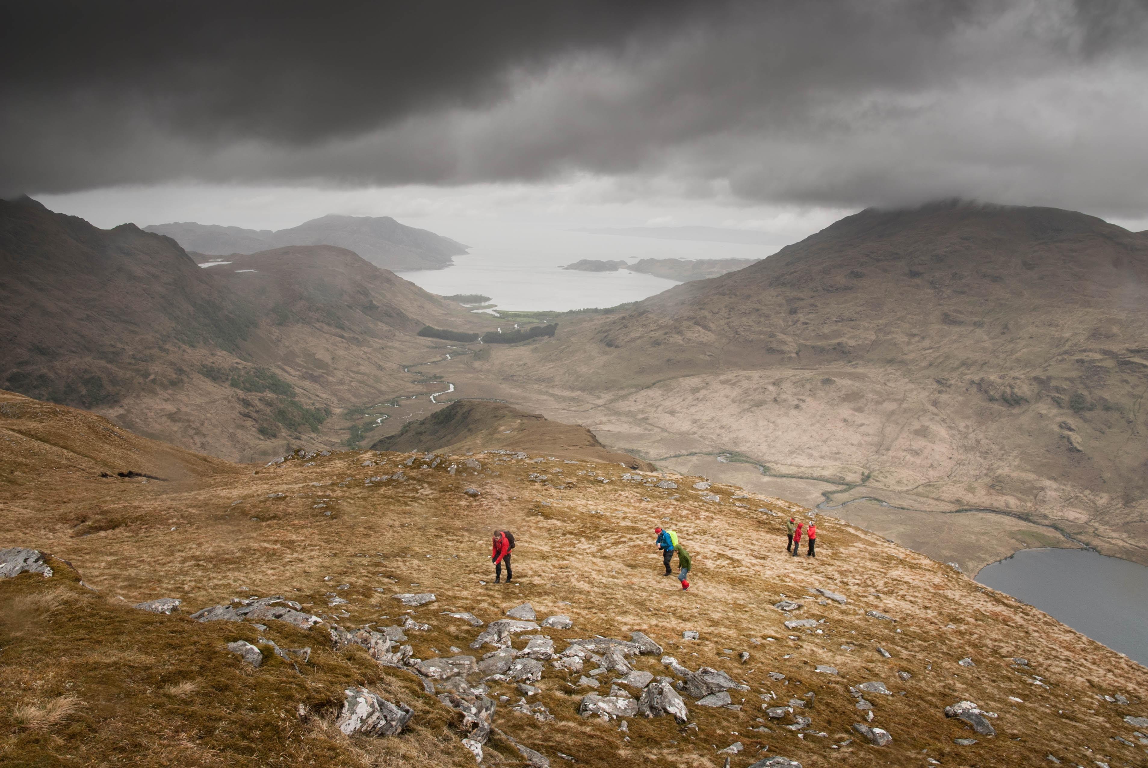 people standing on mountain peak
