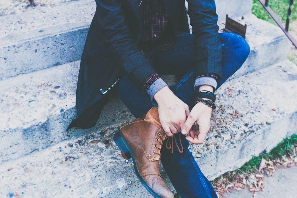 man sitting on concrete stair