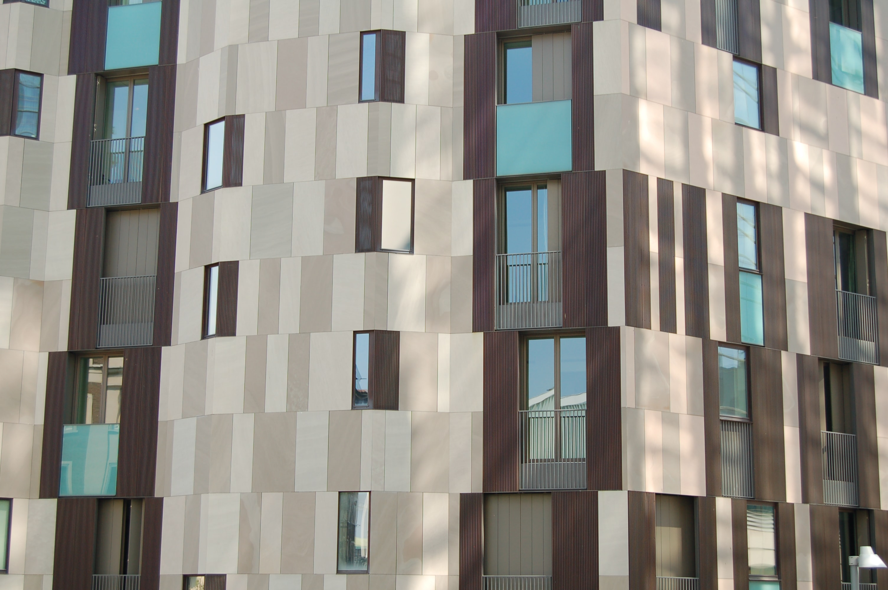 A brown and beige facade of a residential building