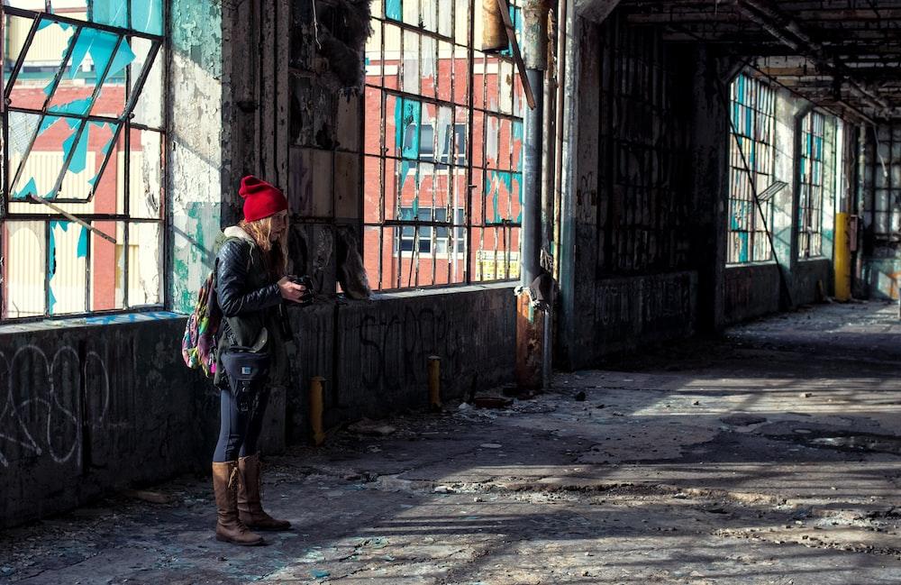 woman standing near building window