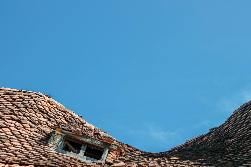 brown brick roof under blue sky during daytime