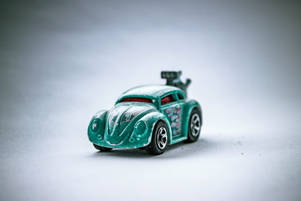 green and white car scale model