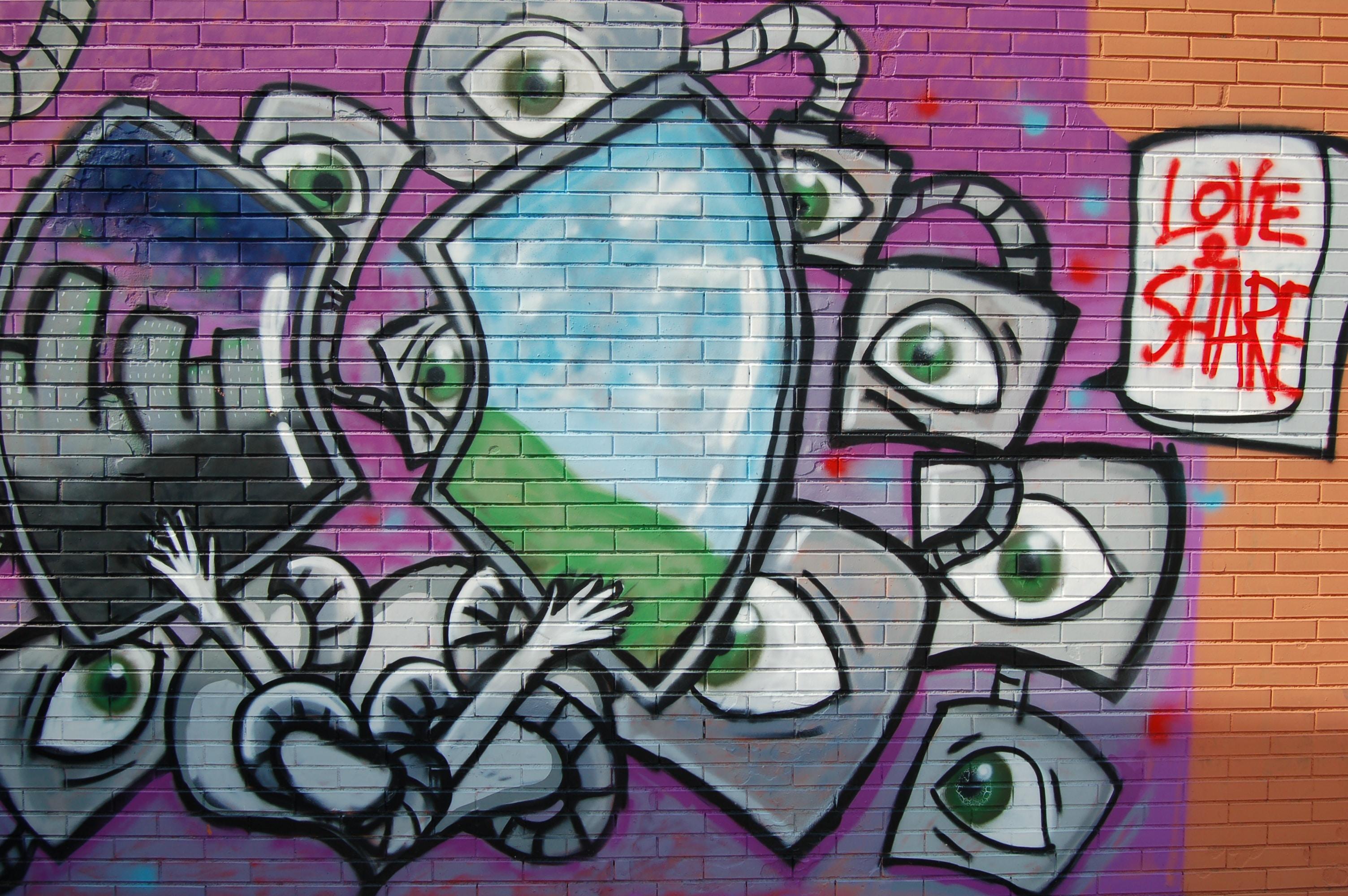 Bright spacey graffiti art on street brick wall