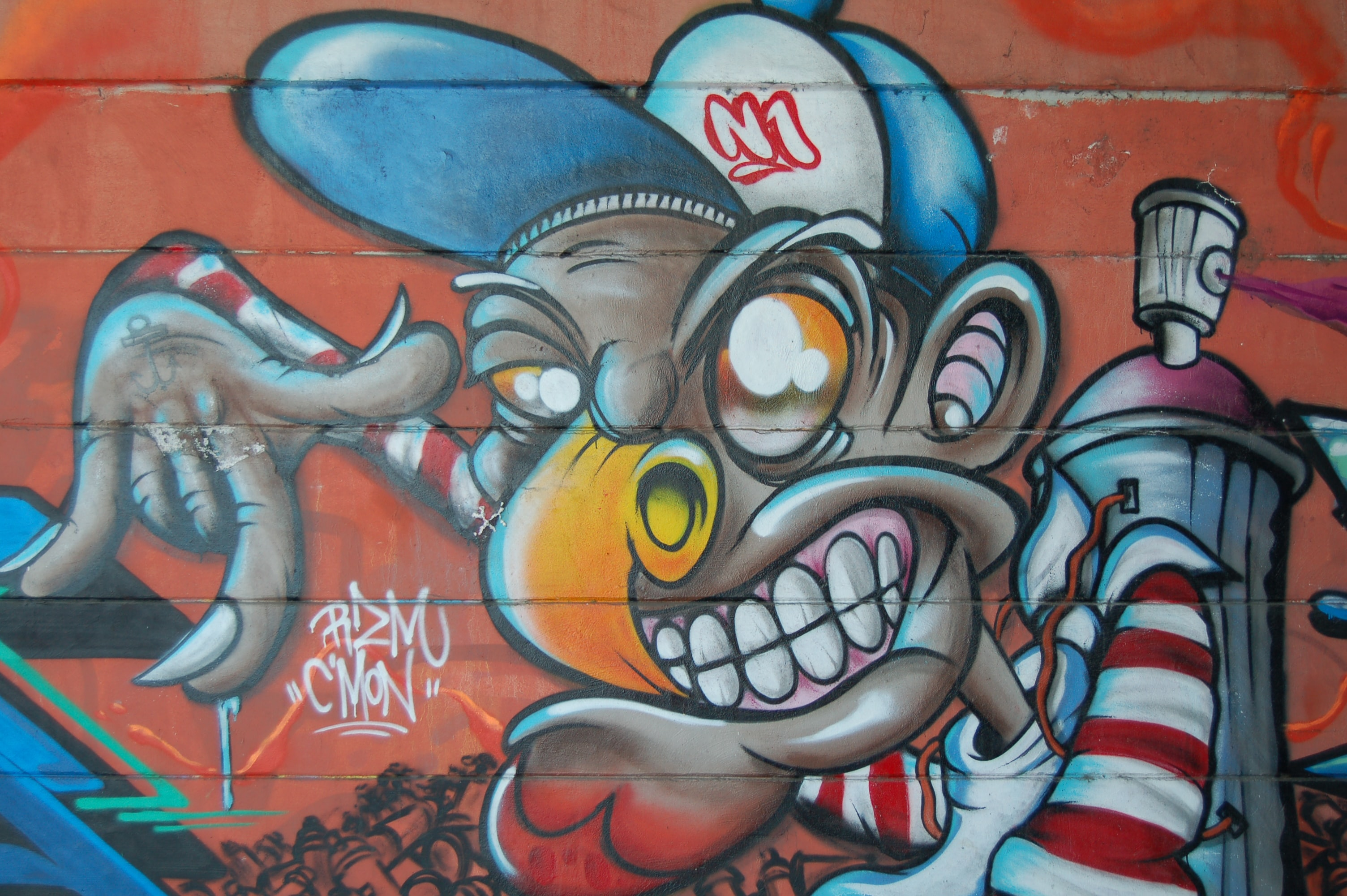A caricature wall mural of an African American tagger.